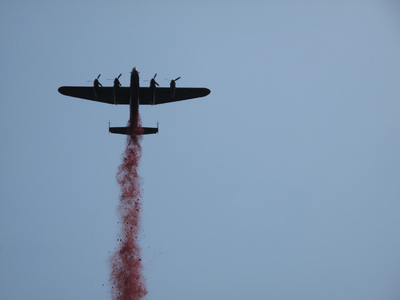 Lancaster Bomber dropping poppies over the Bomber Command Memorial in London - June 28th 2012